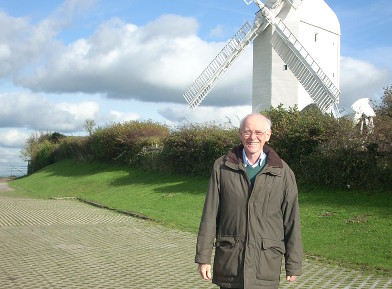 Bill Kent with windmill behind